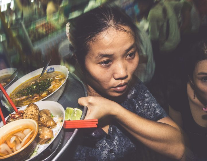 Professional photographer Vietnamese woman delivers great food