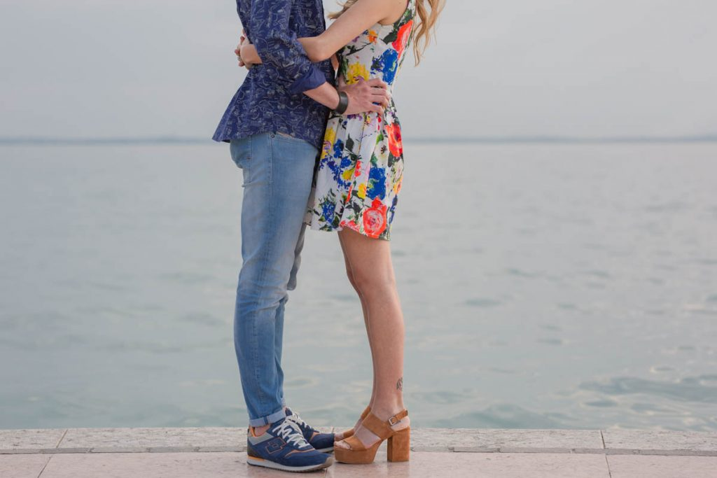 Professional wedding photographer. Engagement photo shoot in Lazise, Lake Garda, Verona