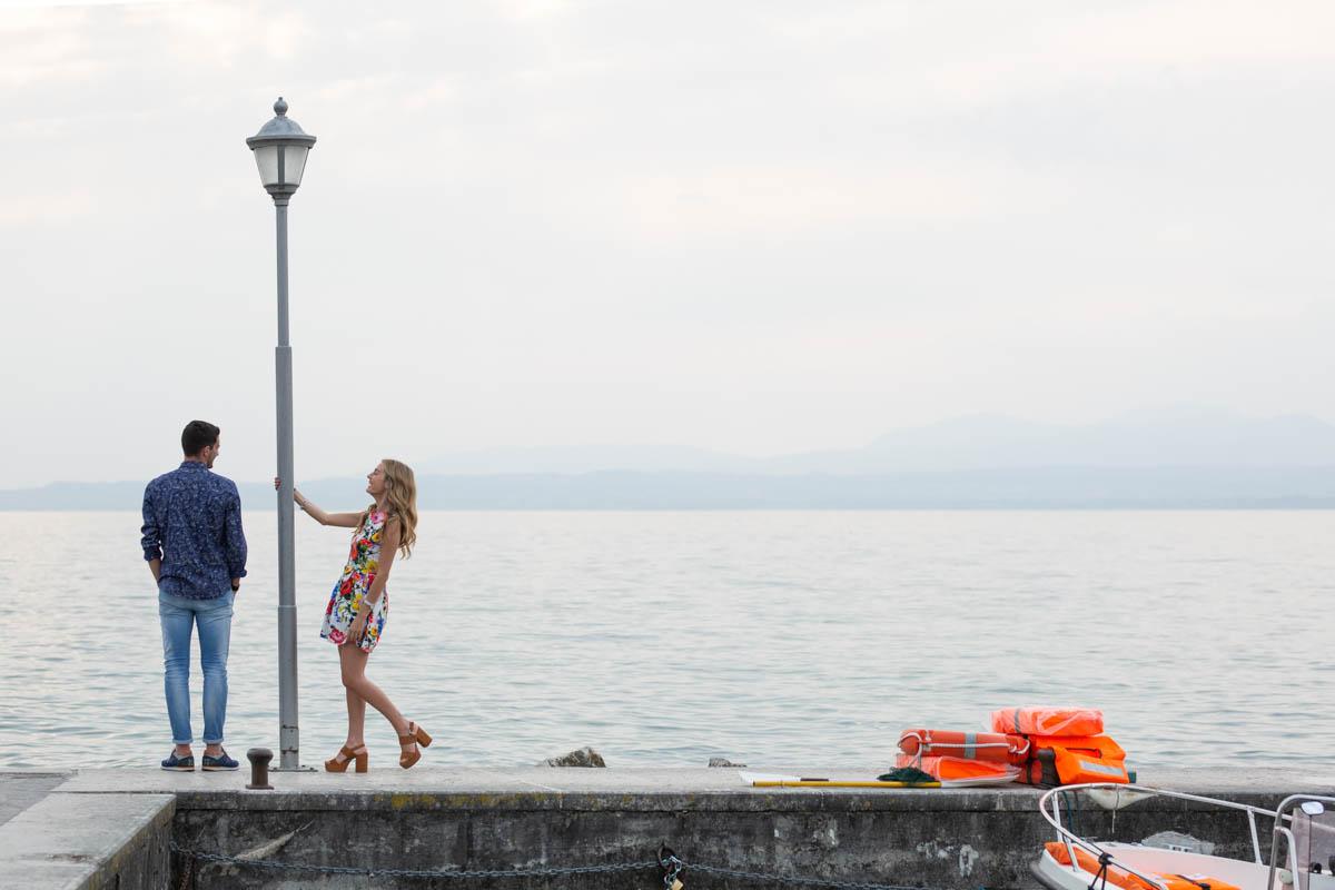 Professional wedding photographer. Engagement photo shoot in Lazise, Lake Garda, Verona