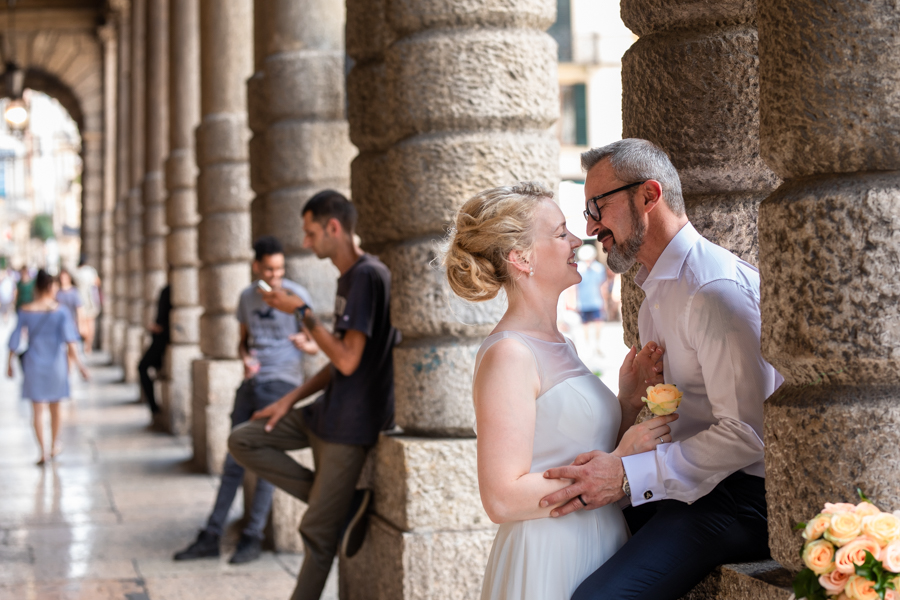 Spouses on Via Roma in Verona, the city of love