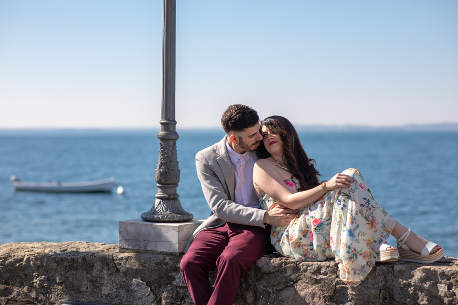 Professional wedding photographer. Couple in love on the shores of Lake Garda