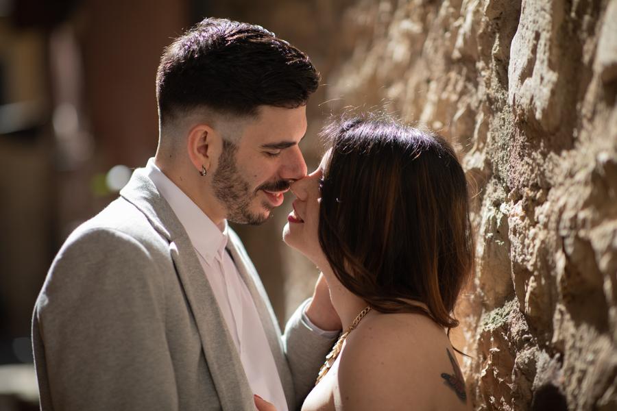 Couple of lovers in the narrow streets of Torri Del Benaco, Lake Garda